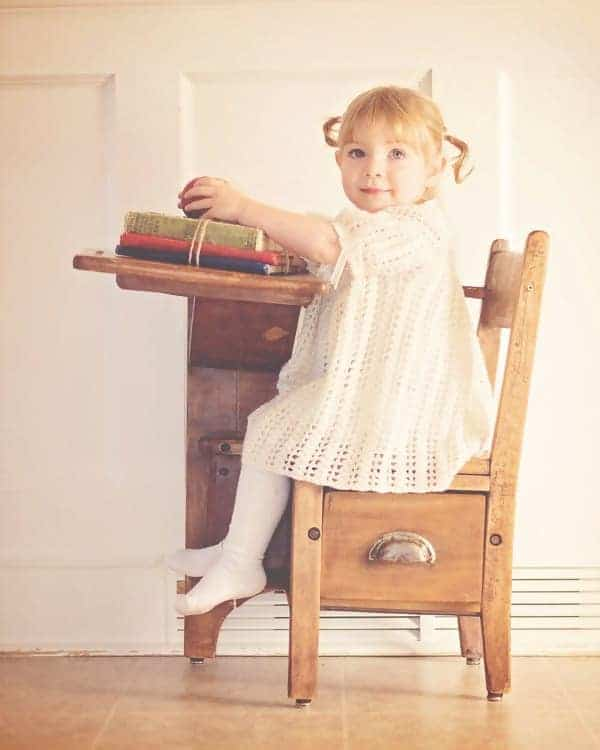 little girl at desk how to teach baby about god